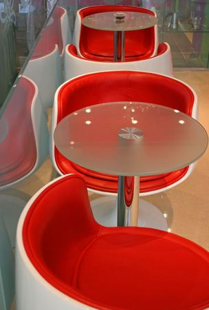 Modern red chairs and table Stock Photo