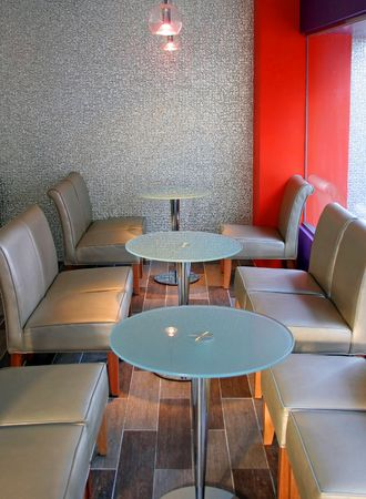 Funky cafe with silver chairs photo
