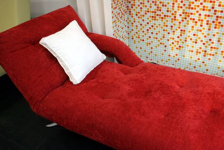 Bright red sofa bed - home interiors Stock Photo