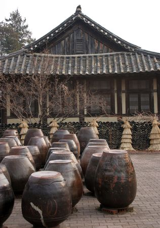 buddhist structures: Kimchi pots in front of a traditional Korean house at Suwon Folk Village, South Korea