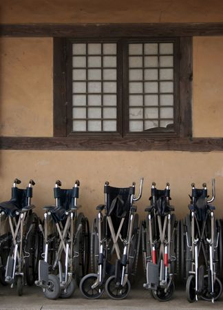 A row of wheelchairs photo
