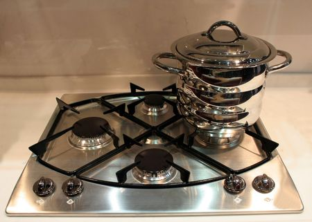 Stainless steel oven top with a pot photo