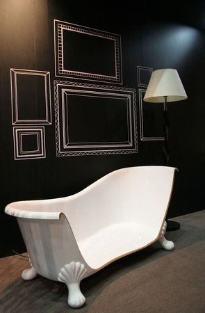Cut off bathtub with a lamp in a living room - abstract home interior photo