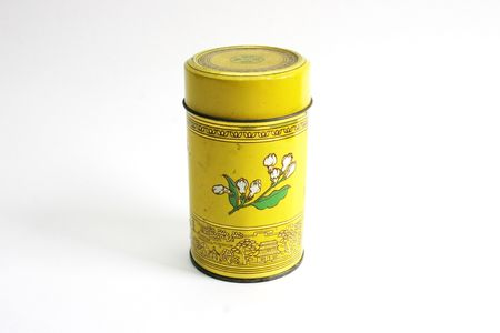 Old Chinese tea tin on bamboo - isolated photo
