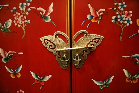 Bright butterfly door on Chinese-style furniture Stock Photo - 378291