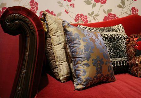 Red sofa and modern cushions - home interiors photo