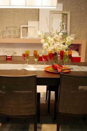 Colored wine glasses on a table in modern dining room