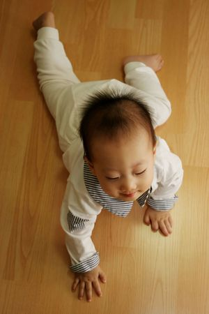 Young baby crawling on the floor photo