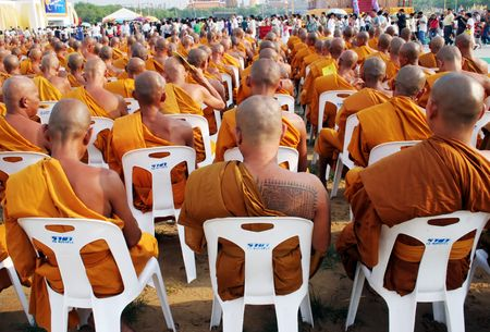 Monks gather to celebrate Buddhas birthday and the 60th anniversary of the Kings accession to the throne, Bangkok, Thailand.