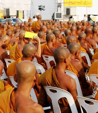 Monks gather to celebrate Buddhas birthday and the 60th anniversary of the Kings accession to the throne, Bangkok, Thailand. photo