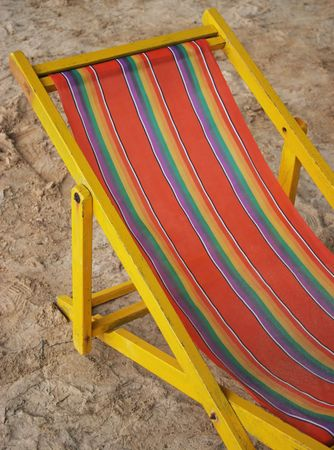 Bright old deck chair on the beach Stock Photo - 413727