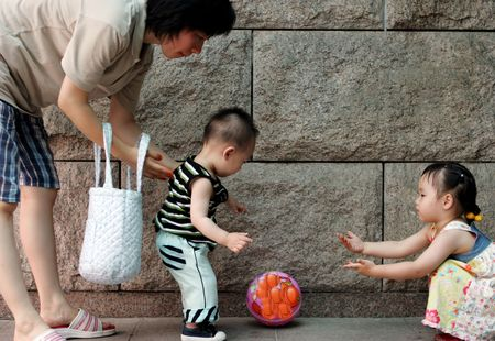 Korean mother plays ball with her children photo