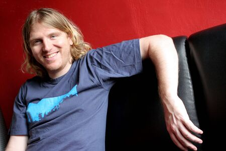 laid back: Blond man looking casual and laid back Stock Photo