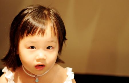Asian girl with a serious expression