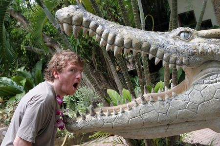 Man with his head in a crocodiles mouth photo