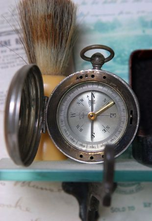Old compas on a shelf - shallow dof
