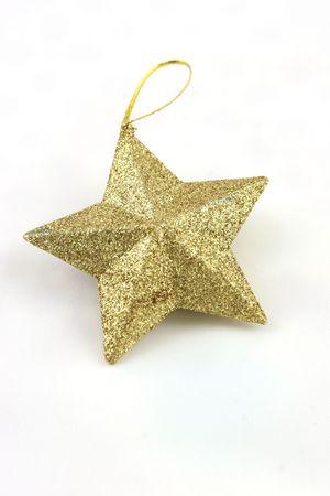 Gold Star geformt Weihnachtsschmuck auf wei�em Hintergrund Lizenzfreie Bilder