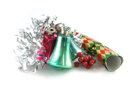 christmas cracker: Christmas tinsel, bells, xmas cracker and berries isolated Stock Photo