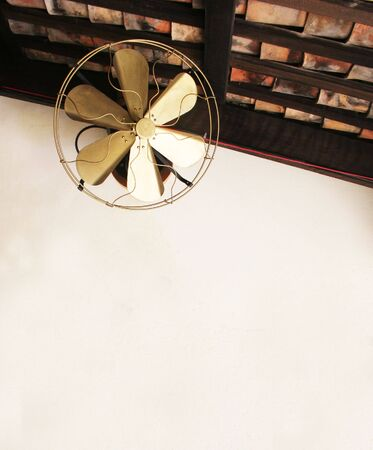 Gold old fashioned ceiling fan - copy space photo