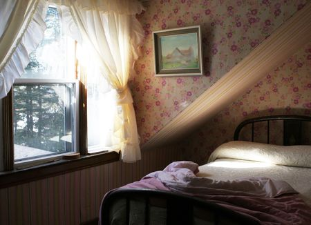 Light flowing through the window of a bedroom