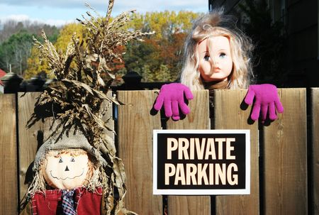 Private parking sign with scarecrow and doll 版權商用圖片