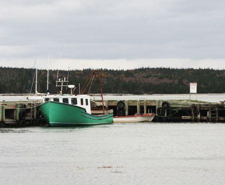 green boat: Green boat moored at a dock