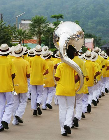 Boys marching band dressed in yellow uniforms photo