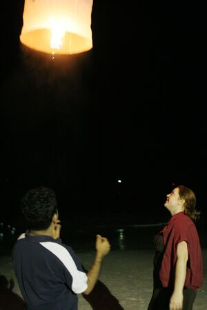 Couple release Asian lantern that represents good luck and long life photo