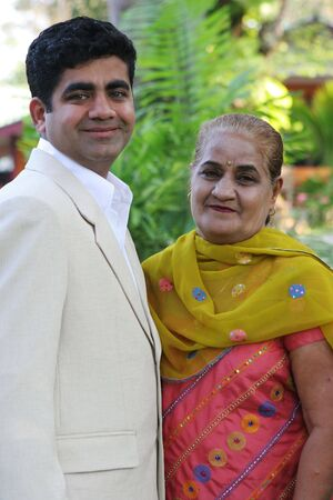 interracial family: Attractive Indian man with his mother