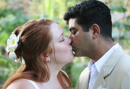 Bride and groom kiss on their special day photo