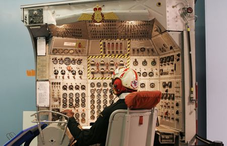 Display of a pilot mannequin at an aircraft control panel - EDITORIAL. photo