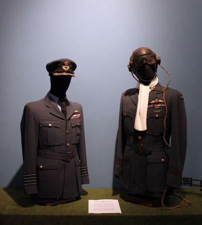 flew: Royal Canadian Air Force officers dress tunics on display at the Greenwood Aviation Military Museum, Nova Scotia, Canada. Pilots often flew in their uniforms with just the helmet, goggles and life jacket on top.
