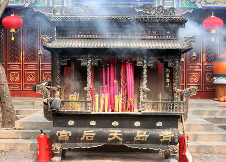 Incense burning at a temple during Chinese New Year celebrations in Qingdao, China (haze is smoke). photo