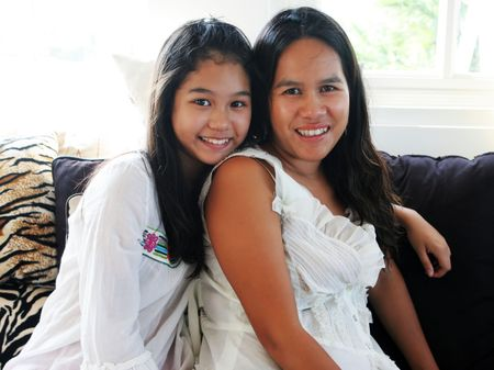 appealing attractive: Happy Asian family - mother and teenaged daughter