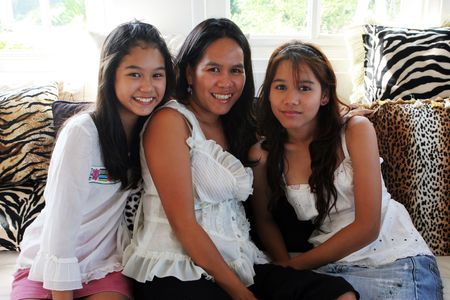 teenaged: Happy Asian family - mother and teenaged daughters