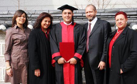 Happy university graduate with his family.