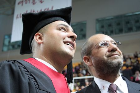 Happy university graduate with his father. Stock Photo - 821550