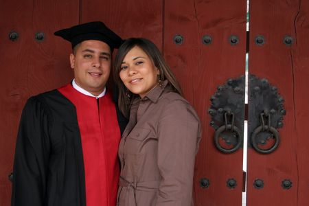 University graduate with his wife - happy and successful photo