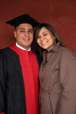 Graduation day for attractive young man and his beautiful girlfriend. photo
