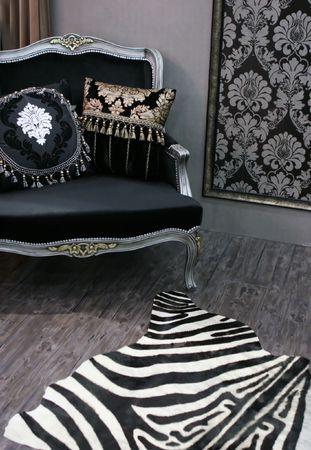Modern room with zebra stripe mat - home interiors Stock Photo