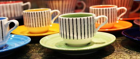 Bright pottery cups - home interiors
