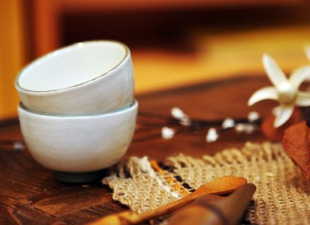 Asian pottery cups for drinking tea or sake - shallow DOF