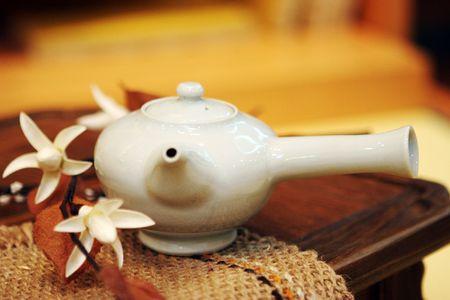 White Asian tea pot - shallow DOF