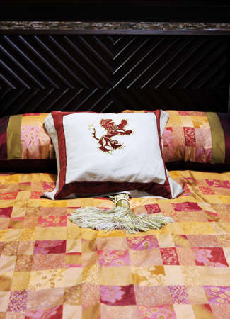 Bed with colorful linen - home interiors Stock Photo - 827901