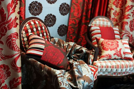 arm chairs: Luxurious red arm chairs with satin pillows - home interiors