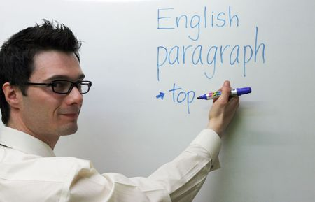docenten: Leraar Engels te schrijven op het bord Stockfoto