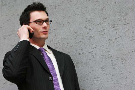 makes: Smart businessman makes a phone call