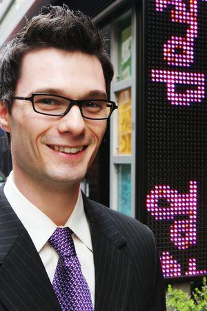 career fair: Happy businessman in the city