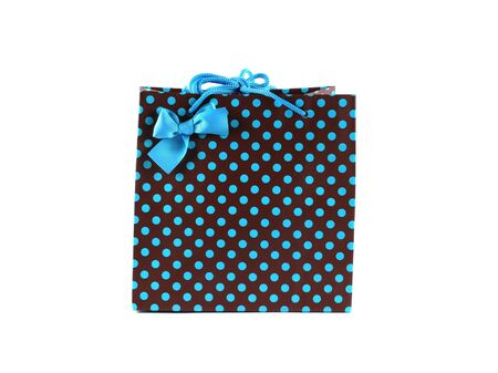 Brown and blue spotted gift bag isolated on white. Stock Photo