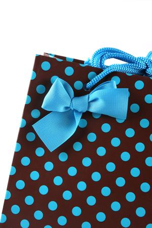 Brown and blue spotted gift bag isolated on white. photo